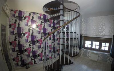 Installation d'un escalier hélicoïdale avec création de trémie